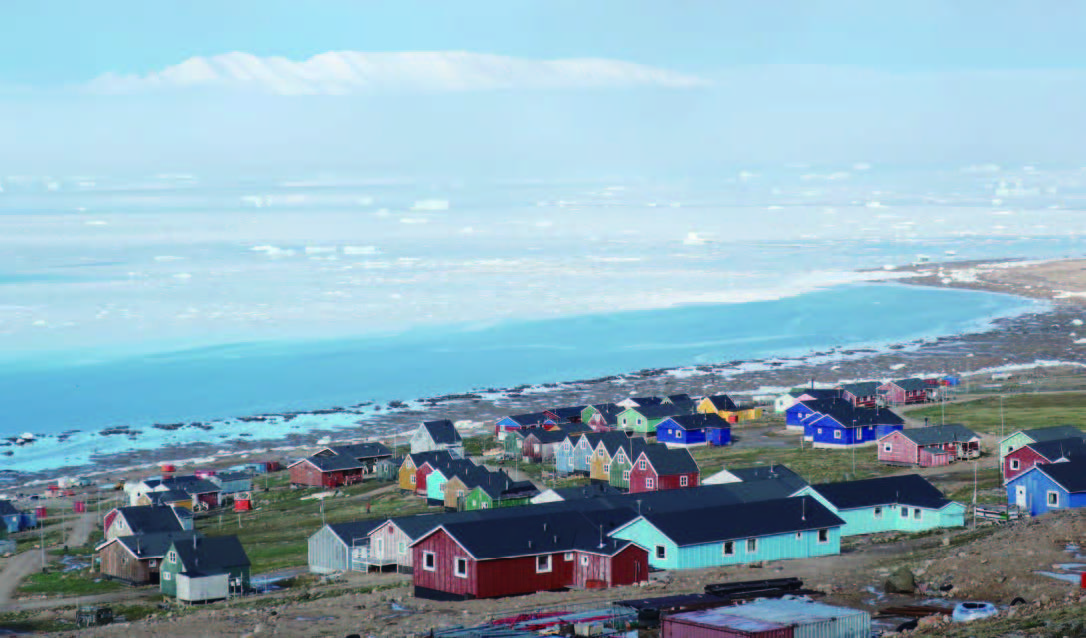 In July, sea ice finally leaves the shore of the small town of Qaanaaq in Greenland, where 600 residents await the arrival of the short summer